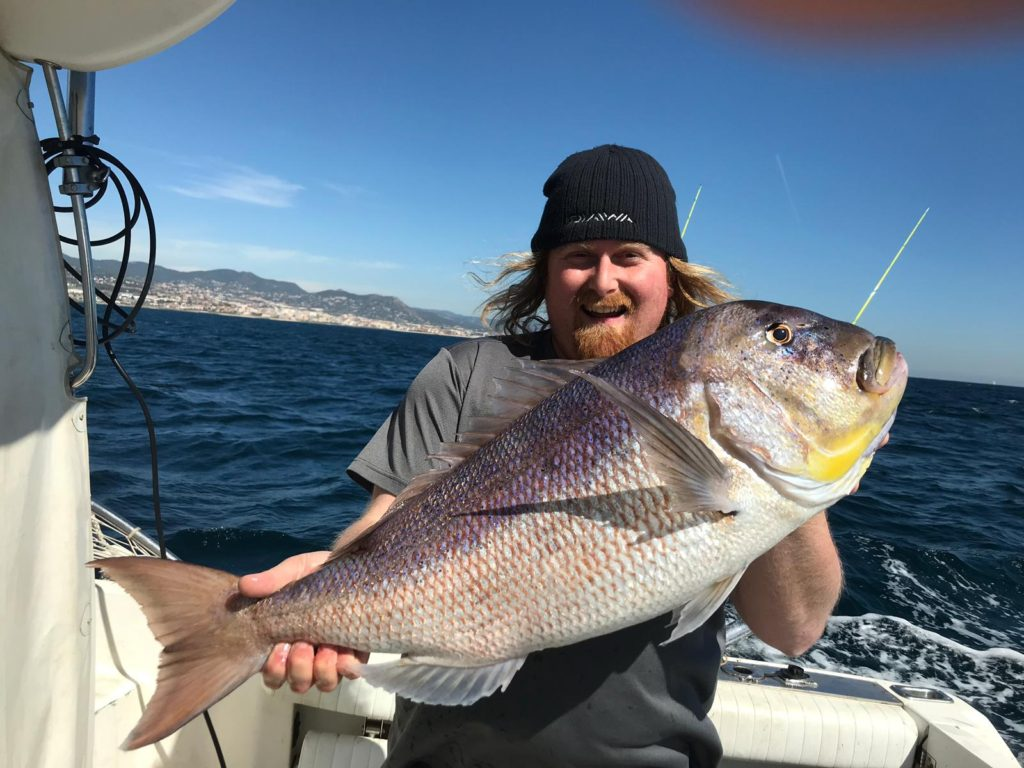 friends with a fishing charter in Barcelona