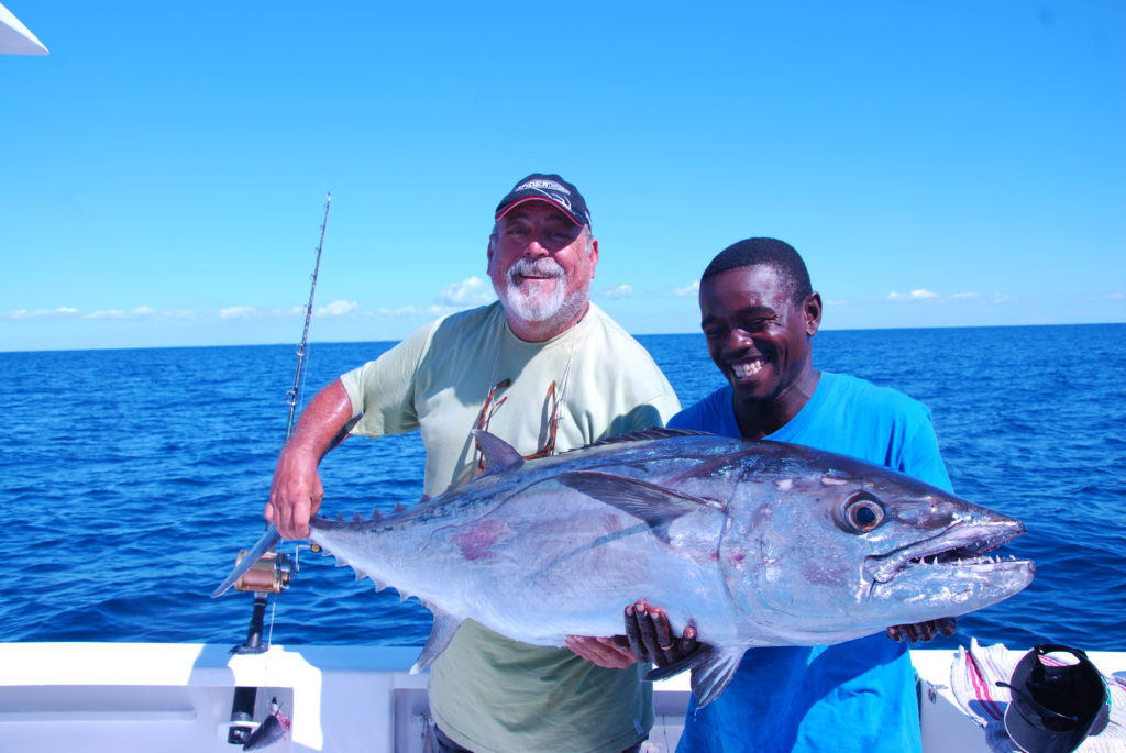 Manou and his mate with a great Dogtooth tuna